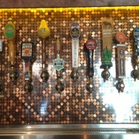 Photo taken at Flying Saucer Draught Emporium by Jesse J. on 8/24/2012