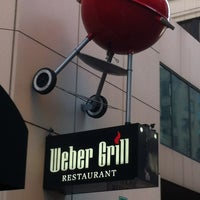 Photo taken at Weber Grill Restaurant by Jonathan B. on 6/8/2012