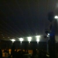 Photo taken at public bar by Bihter K. on 5/19/2012