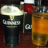 Photo taken at Garryowen Irish Pub by Becca J. on 7/21/2012