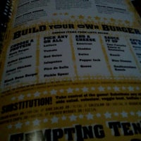 Photo taken at Buffalo Wild Wings by Alejandra G. on 7/20/2012
