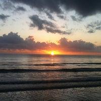 Photo taken at Four Mile Beach by Obi F. on 4/6/2012