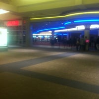 Photo taken at AMC Mayfair Mall 18 by Abdullah A. on 2/19/2012