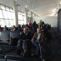 Photo taken at Gate 5 Aeropuerto Internacional Juan Santamaria by Alejandro on 8/15/2012