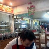 Photo taken at Mahogany Market by Myles V. on 9/8/2012