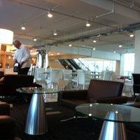 Photo taken at Louis' Tavern CIP Lounge by Mark R. on 4/18/2012