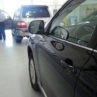 Photo taken at Holman Toyota Scion by Kijung L. on 3/19/2012