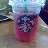 Photo taken at Starbucks by Lara C. on 7/13/2012