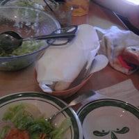 Photo taken at Olive Garden by Cassie B. on 8/2/2012
