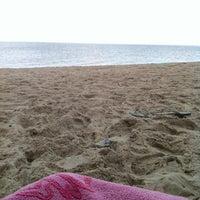 Photo taken at Sea Street Beach by Gabby H. on 8/11/2012