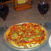 Photo taken at MacKenzie River Pizza Co. by Shan O. on 8/15/2012