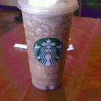 Photo taken at Starbucks by Lupe B. on 5/29/2012