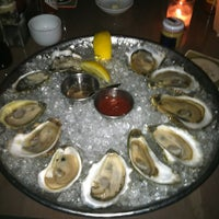 Photo taken at Island Creek Oyster Bar by Su L. on 7/7/2012