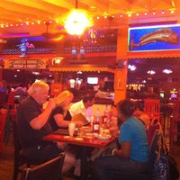 Photo taken at Green House Bar & Restaurant by Julie A. on 9/7/2012