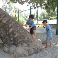 Photo taken at Garfield Park by Taj C. on 8/2/2012