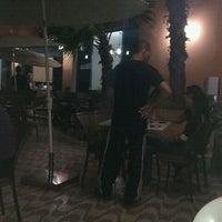 Photo taken at Luna Beach Bar by Bruno N. on 3/24/2012