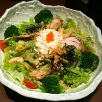 Photo taken at Watami Japanese Casual Restaurant by Pei Q. on 3/25/2012