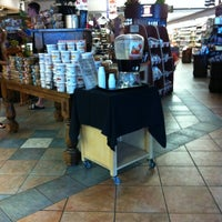 Photo taken at AJ's Fine Foods by Rebecca S. on 5/12/2012