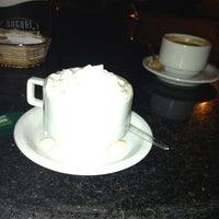 Photo taken at Auguri Café by Helvio N. on 3/16/2012