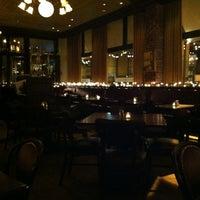 Photo taken at Bravo Brasserie Restaurant by Madahme T. on 4/30/2012