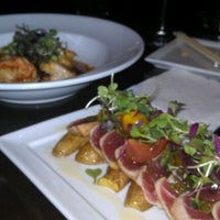Photo taken at Koi Restaurant by Bridget A. on 2/9/2012