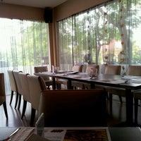 Photo taken at Pisa Kafe by Ricky S. on 6/10/2012