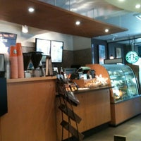 Photo taken at Starbucks by Kuspinasti S. on 7/22/2012
