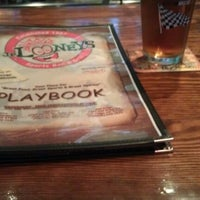 Photo taken at JP Looney's Sports Bar And Grill by Adam S. on 4/1/2012