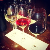 Photo taken at Uncorked Tasting Room & Wine Bar by Neptune K. on 6/9/2012