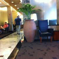 Photo taken at Delta Sky Club by Brad L. on 7/12/2012