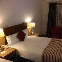 Photo taken at Clayton Hotel by Richard P. on 3/12/2012