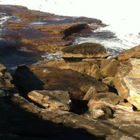 Photo taken at Tamarama Beach by Clea R. on 7/3/2012