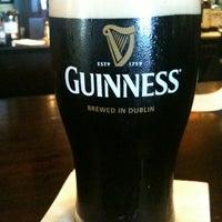 Photo taken at Tigín Irish Pub & Restaurant by 💀Robert P. on 5/12/2012