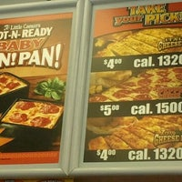 Photo taken at Little Caesars Pizza by Invisible on 4/29/2012