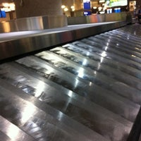 Photo taken at Baggage Claim by Marriet E. on 8/9/2012