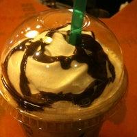 Photo taken at Starbucks by Işıl K. on 4/19/2012