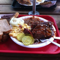 Photo taken at Augie's Barbed Wire Smokehouse by Christopher B. on 5/18/2012
