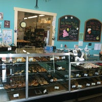Photo taken at Madeleine's Bakery by Angela W. on 5/12/2012