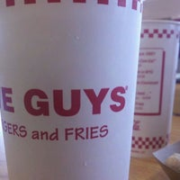Photo taken at Five Guys by Dylan A. on 3/22/2012