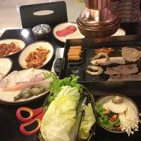 Photo taken at Kimju by Frank villa on 8/26/2012