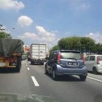 Photo taken at Lebuhraya Persekutuan (Federal Highway) by QiauWei T. on 5/4/2012