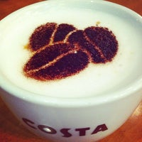 Photo taken at Costa Coffee by Jun Y. on 3/8/2012