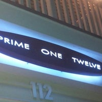 Photo taken at Prime One Twelve by Adrienne S. on 7/30/2012
