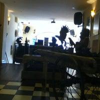 Photo taken at Mink Tattoo Coffee Bar by Lauren S. on 9/4/2012