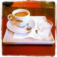 Photo taken at John John Cafe by Auyri F. on 6/20/2012