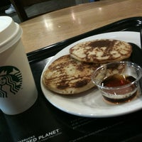Photo taken at Starbucks by Juliana R. on 7/19/2012