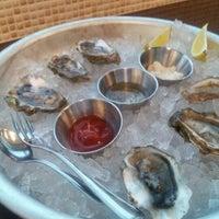 Photo taken at Cat Cora's Kitchen by Carolyn K. on 2/29/2012