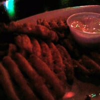 Photo taken at The Beetle Bar and Grill by Michelle C. on 2/6/2012
