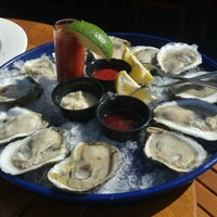 Photo taken at Beach Creek Oyster Bar & Grille by Kim C. on 7/6/2012