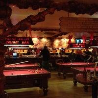 Photo taken at Million Dollar Cowboy Bar by Elizabeth R. on 5/9/2012